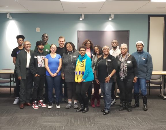 Photo of PCK's Andrew Currier and Jillian Carter with youth participants and organizers at the IP workshop for Roots Community Services in Brampton Ontario