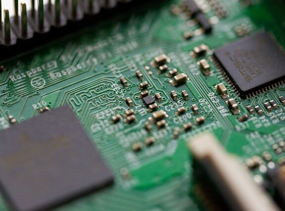 Close up view of a green circuit board for a computer