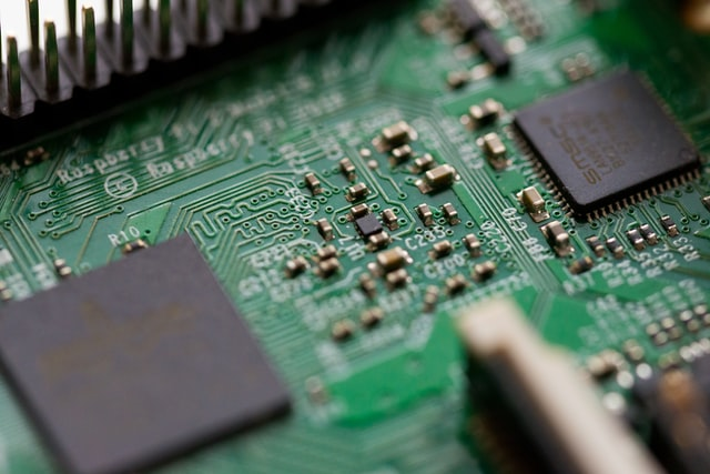Close up view of a green circuit board.