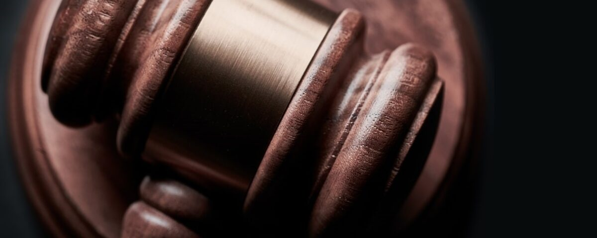 Close-up photograph of a wooden judge's gavel.