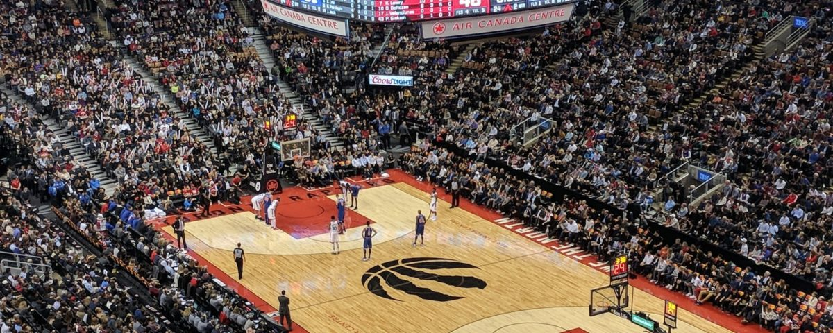 Photo of the Raptors NBA logo on the court of Scotiabank arena