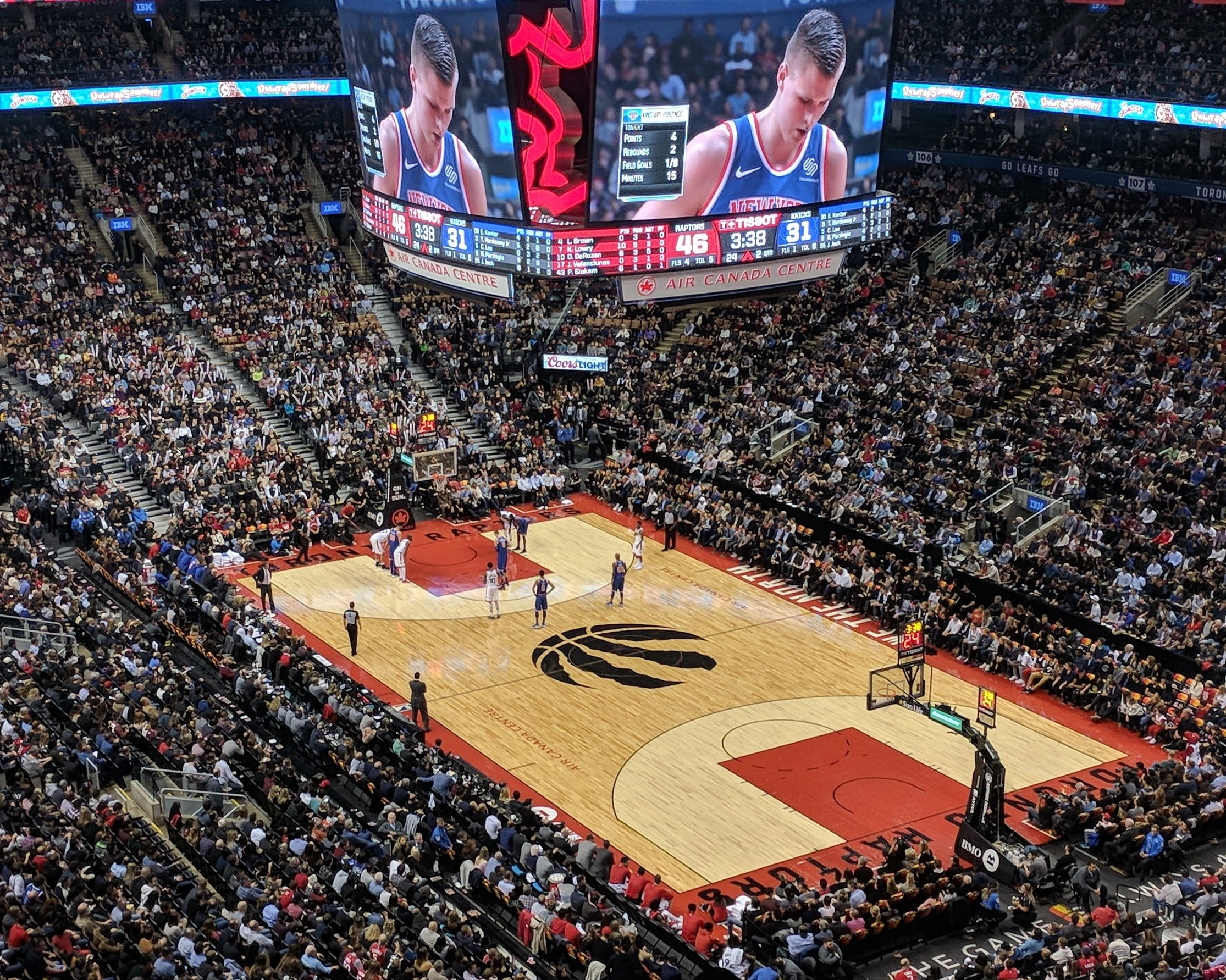 Photo of the Raptors trademark on the court of Scotiabank arena.