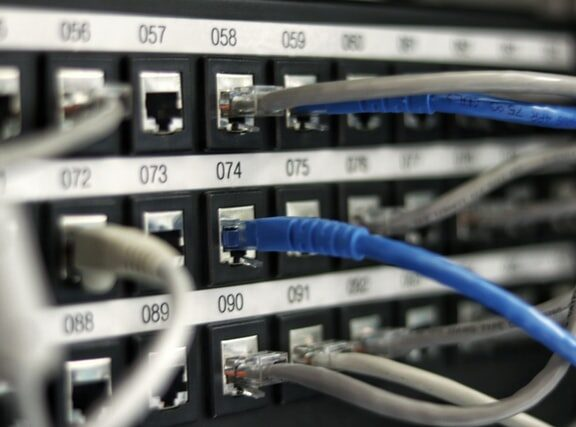 Close-up photograph of server with multiple ethernet cords plugged in