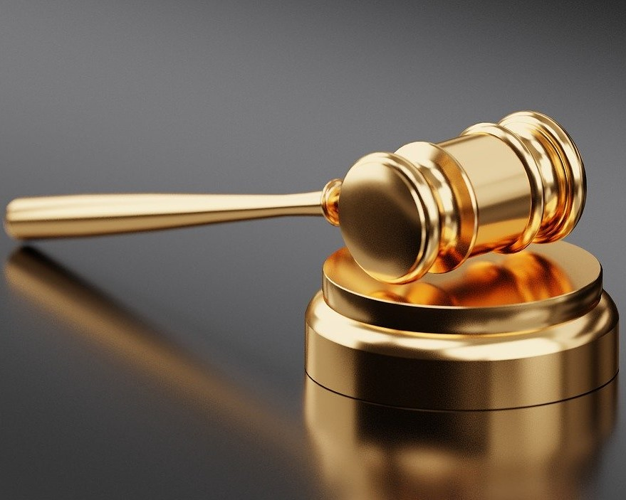 Photo of a judge's golden gavel in court.