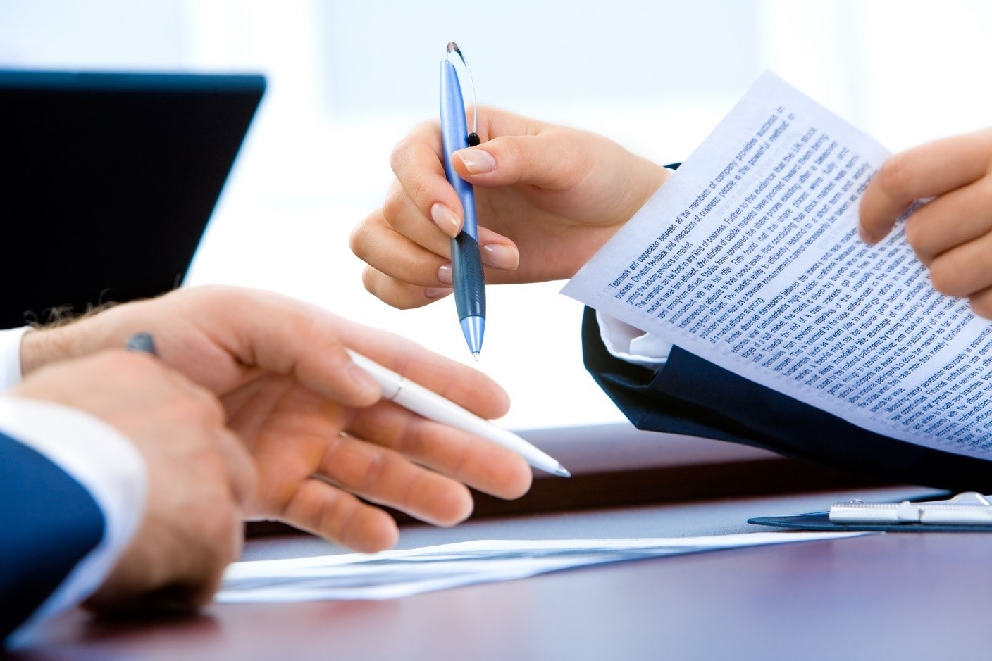 Photo of a contract or license being signed.