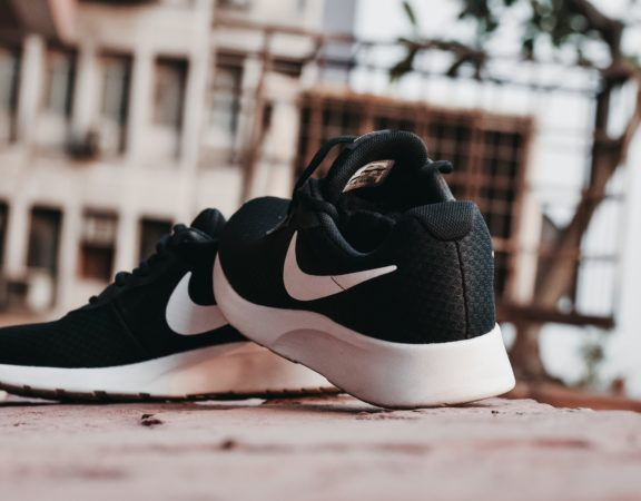 Pair of black and white Nike running shoes