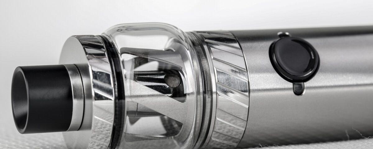 A close-up photograph of a metal vaporizer or vape-pen
